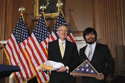 Senate Majority Leader Harry Reid of Nev., left, and Filipino Congressman and eight-term world champion boxer Manny Pacquiao are seen on Capitol Hill in Washington, Tuesday, Feb. 15, 2011, after they exchanged flags. Photo by Alex Brandon/AP