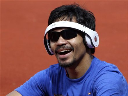 Pacquiao smiles as he takes a break from his training. Photo taken on March 21, 2011 by Bullit Marquez/AP