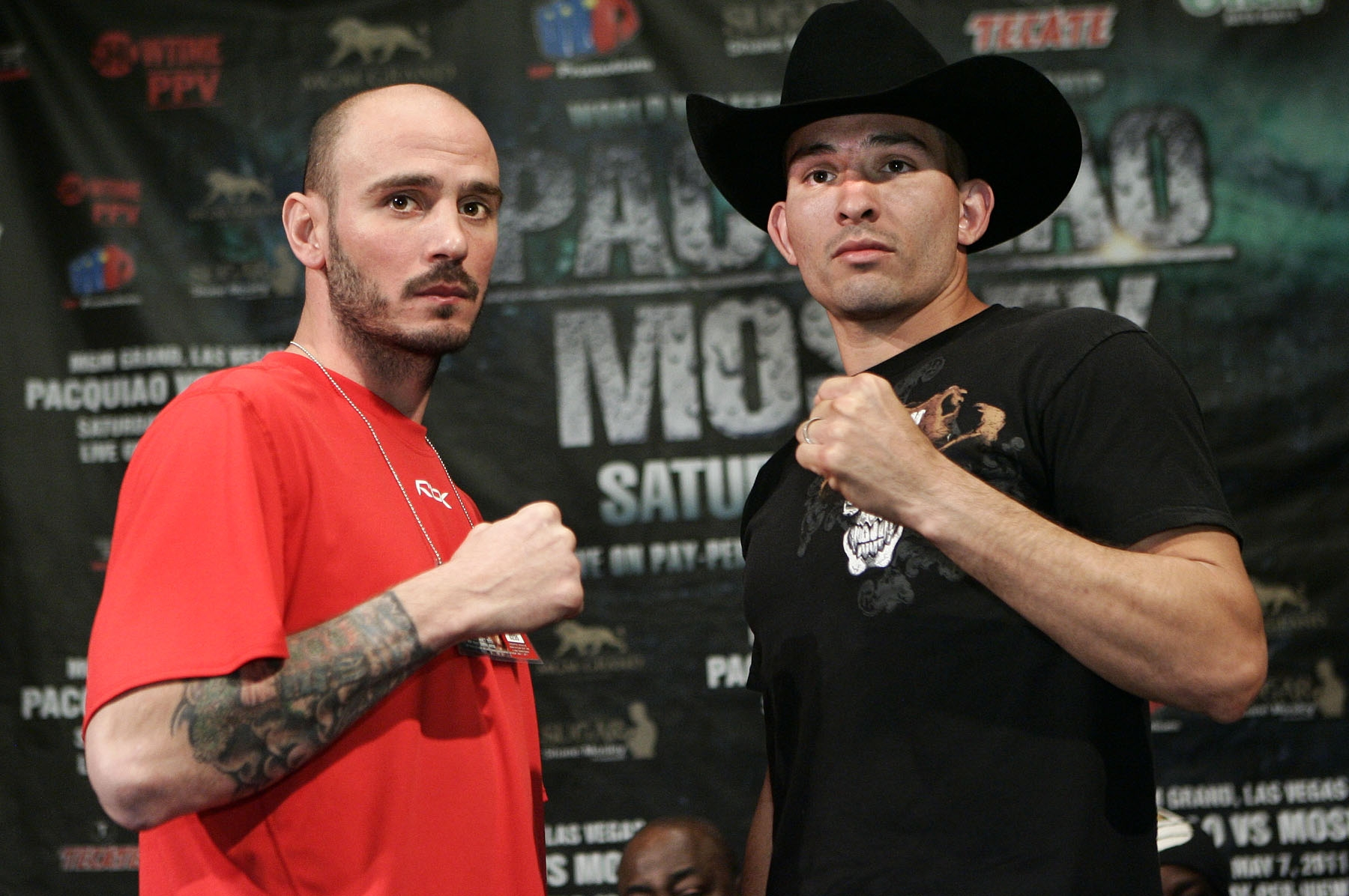 """Former world champion Kelly """"The Ghost"""" Pavlik, Youngstown,Ohio and Alfonso Lopez,Cut & Shoot,Texas pose during the press conference at the MGM Grand for their upcoming feature fight on the undercard of Pacquiao vs Mosley on Saturday, May 7.  Photo by Chris Farina - Top Rank"""