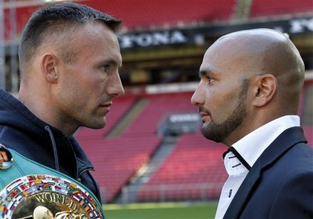 Mikkel Kessler, left, faces France's boxer Mehdi Bouadla, right, in Copenhagen, Monday, May 9. Photo by Lars Poulsen/AP