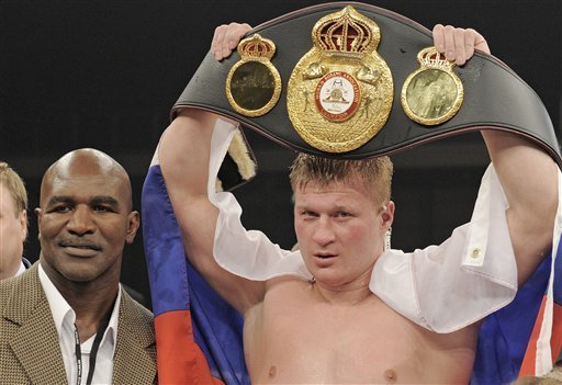 lexander Povetkin of Russia holds the beld besides the former world heavyweight champion Evander Holyfield of the U.S. after the WBA heavyweight title bout against Ruslan Chagaev of Uzbekistan in Erfurt, central Germany, on Saturday, Aug. 27, Photo by Jens Meyer