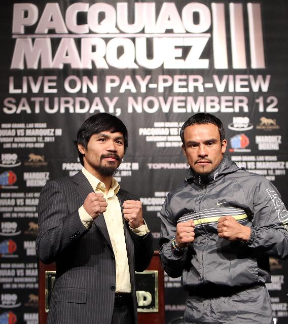 Manny Pacquiao and Juan Manuel Marquez pose during the final press conference on 11-09-11 Photo by Chris Farina
