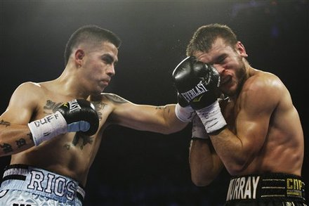 Brandon Rios, left, punches Britain's John Murray
