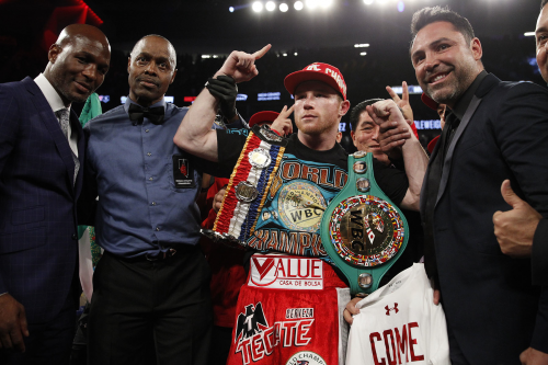 "(From left to right) Future Hall of Famer and Golden Boy Promotions Partner Bernard Hopkins, Referee Kenny Bayless, WBC, Ring Magazine and Lineal Middleweight World Champion Canelo Alvarez and Golden Boy Promotions Chairman and CEO Oscar De la Hoya pose after Canelo's sixth round knockout victory over former Two-Time World Champion Amir ""King"" Khan on May 7, 2016 at the T-Mobile Arena in Las Vegas. Photo by Tom Hogan"